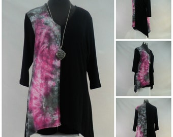 Size M tie dye tunic top with V-neck, 3/4 sleeves, and shark bite hemline in bamboo blend fabric.
