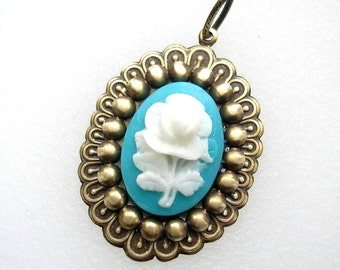 Turquoise Blue and White Floral Cameo Pendant in Antiqued Brass