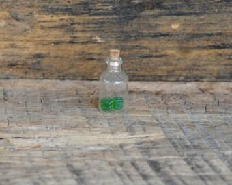 Vintage Miniature Green Dice in A Miniature Glass Bottle