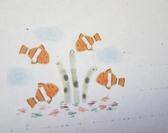 letter paper / clown fish