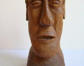 Hand made wooden sculpture representing the head of a man