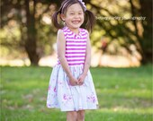 """Clearance sale on remaining sizes!  Girls  """"wallflower""""  dress .     Available girls 6 months to 3t left"""