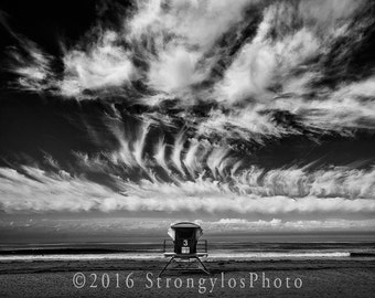Imperial Beach, California photography, black and white photo, lifeguard tower on sandy beach, cloudy sky