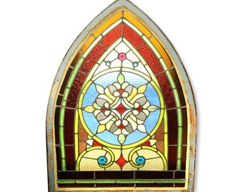Wreath design stained glass arched window