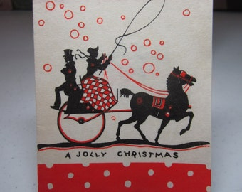 Colorful red and black 1930's art deco christmas card victorian lady taking the reins of a horse drawn carriage snow falling majestic horse