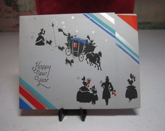 Colorful art deco 1920's-30's silver gilded happy new year card victorian men, woman and children holding gifts horse drawn coach, dogs,