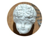 vintage antique damaged German bisque doll head with bonnet from Elizabeth Rosen