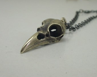 Tiny Raven Skull Necklace, yellow brass, 1 inch