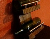 Wall mounted wine rack crafted from found wood and steel handles
