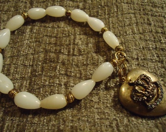 Boho Gypsy Inspired Off White & Gold Tone Beads With Antique Gold Tone Queen Heart Pendant Bracelet
