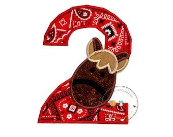 Horse number 2 birthday iron-on applique with red bandana print and a horse's head in brown speckled fabric, embroidered reign, trimmed