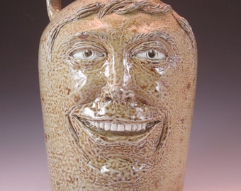 Two-Faced Jug. One side is happy, and the other side is not-so-happy.