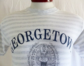 Go Hoyas vintage 90's Georgetown University heather grey white horizontal stripe graphic t-shirt navy blue grey college crest logo small med