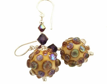Boreas lampwork earrings with bumpy pink purple metalic, topped with a Velvet Purple and Light Amethyst Swarovski crystals, Sterling silver