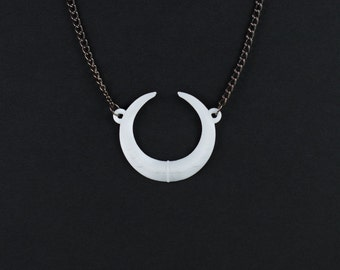 The Eclipse Necklace in White - A necklace with the Sun and Moon hiding from each other