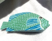 Small wooden painted fish