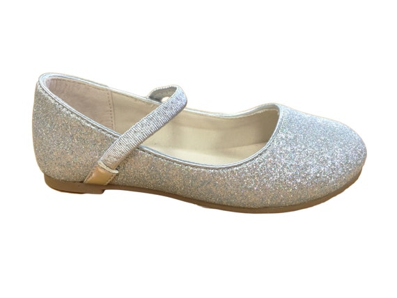 The iconic French jelly shoes created Basket weave detail and dotted sole T-bar with buckle fastening Made with % recyclable soft PVC Always check the size guide before ordering JELLY SHOES Womens Silver Glitter - Vintage style plastic shoppers, baskets and the French Original jelly shoes.