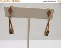 ON SALE AVON Gold Tone Purple Stone Dangle Earrings Item K # 138