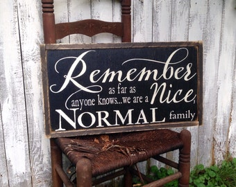 Remember as far as anyone knows we are a Nice Normal Family Rustic Distressed Farmhouse Style Framed Wood Sign 13.5x24