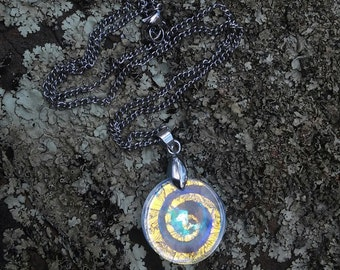 "Cold worked crystallized/dichroic lens spiral jewel with a 20"" sterling silver curb chain"