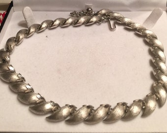Silvertone choker necklace