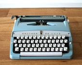 Vintage. 1965 Blue Typewriter. Mid Century. Brother Travel Model. East Germany. DDR. Original Documents included (TY107)