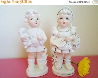 ON SALE Vintage Pair of Figurines, Boy Holding a Puppy, Girl Holding a Basket, Cottage Chic, Shabby Chic
