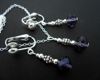 A hand made purple crystal bead  necklace and  clip on earring set.