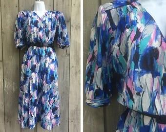 Vintage dress | The Jones Girl watercolor print short sleeve semi sheer wrap front dress with belt