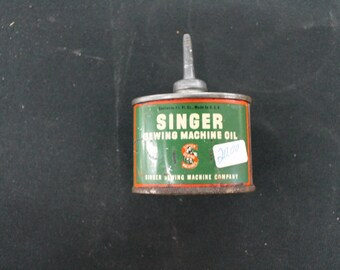 vintage small singer sewing machine oil tin