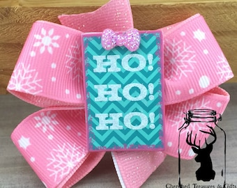 """Pink and White Snowflake Hair Bow with """"Ho! Ho! Ho!"""" Center"""