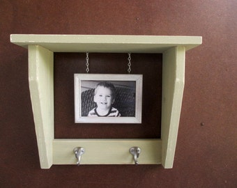 Wall shelf with hanging picture frame
