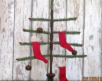 Primitive Faux German Single Feather Tree with rusty star and red pips and red stockings