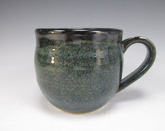 Handmade, stoneware coffee mug. Blue, black and white tea cup