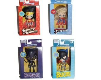 Catwoman. Supergirl. Wonder Woman. Batgirl. Set of 4 DC Comics Super Hero Poseable Dolls Series 1. Super Heroes Mini Dolls. DC Comics. DC.