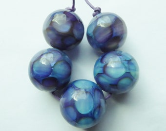 Glass lampwork bead set made with silverglass.