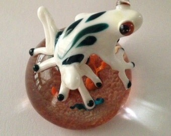 White glass frog on small paperweight