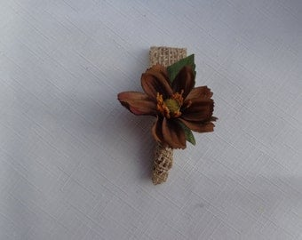 Boutonniere for the ring bearer designed with a chocolate cosmos