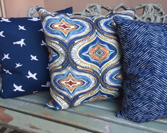 Outdoor pillow slipcovers in indigo blue and orange