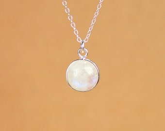 Solitaire necklace - rainbow moonstone - round moonstone necklace - a silver bezel set moonstone crystal on a sterling silver chain