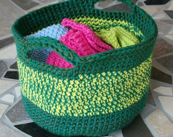 This adorable hand chrocheted basket is made with tones of green with a mixed stripe of green and yellow (Items in tote not included)