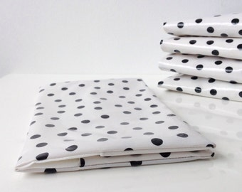 Diaper clutch in white oil cloth with black dots