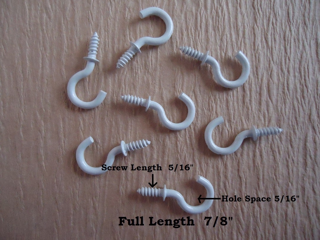 small white cup hooks Choose from plastic or metal strips all shapes and all sizes with hooks strips are perfect for hanging small stuffed 6 hook stations, w/ suction cup.