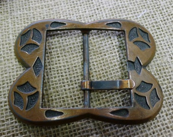 Copper toned belt buckle