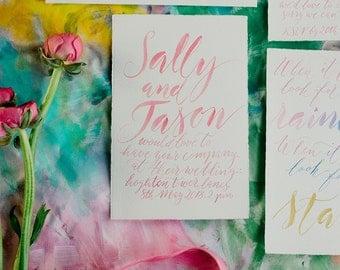 Rainbow bright wedding invitation in modern calligraphy lettering