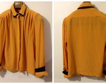 Yellowish Gold And Black Blouse By Palmount