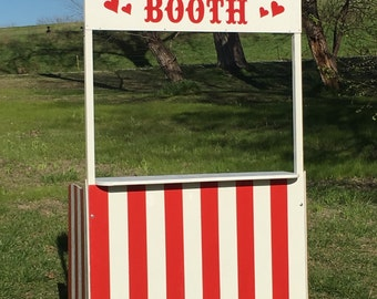Kissing or ticket booth for wedding, trade show, or carnival decor.
