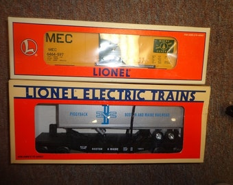 Lionel electric trains,Maine Central boxcar,Boston Maine flatcar  0 or  027 gauge