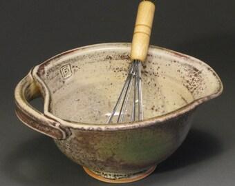 Ceramic egg bowl with whisk, white shino glaze