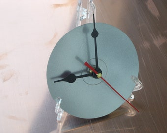 CD clock, is transformed from a table clock with elegant comfortable support to wall clock with the supplied hook